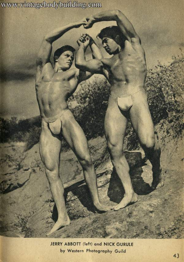 two muscle men outdoors